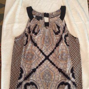 Sleeveless black and tan printed blouse